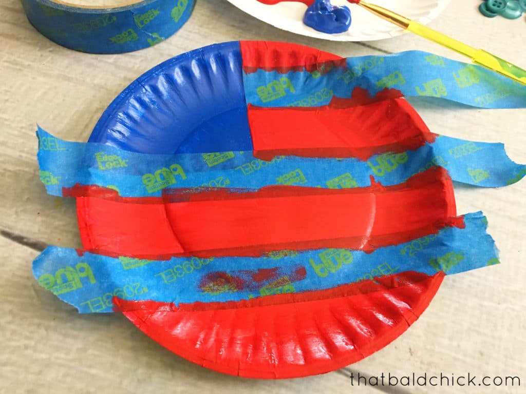 paint red strips on the paper plate flag