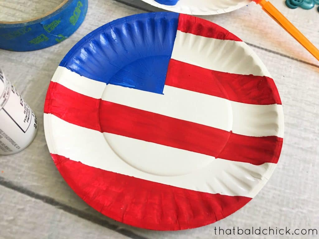 remove tape to reveal white stripes of the paper plate flag