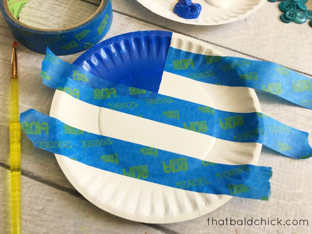 tape off the stripes for the paper plate flag