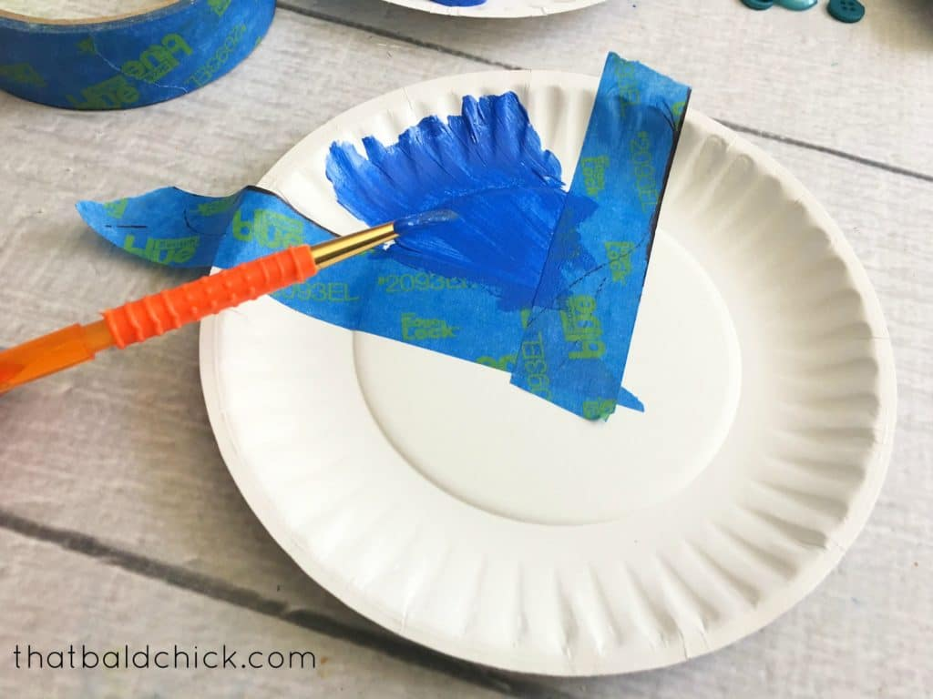 use painters tape to make the union of the paper plate flag