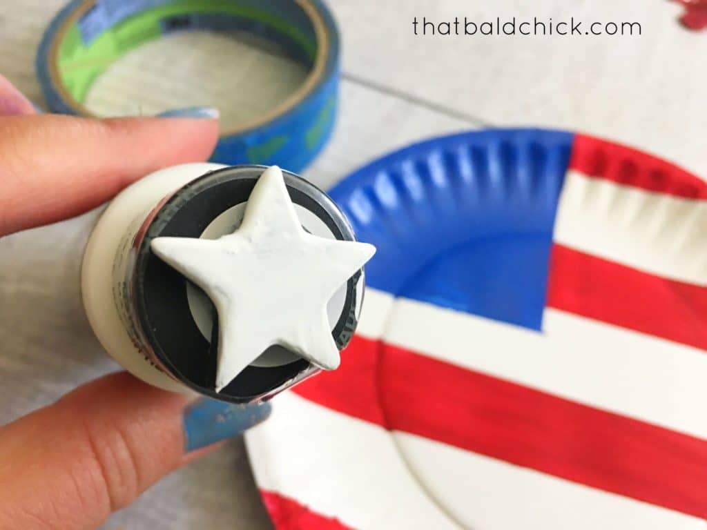 use star stamp to add stars to the paper plate flag